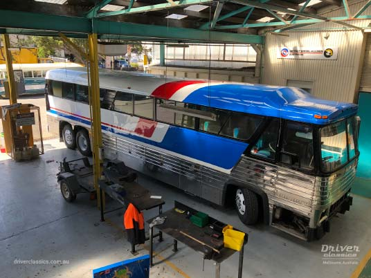 MCI MC8 bus (1976 version), under restoration, in workshop, Pepsi chevron red white and blue stripes, Mt Waverley VIC, Photo taken April 2019