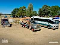 Aerial shot of Driver Classics vehicles: 1977 Kenworth W925 S2, 1986 Kenworth W925 and 1983 GM Denning DenAir Mono bus at the History of Transport Heritage Truck Display, Lancefield VIC, Photo taken February 2019