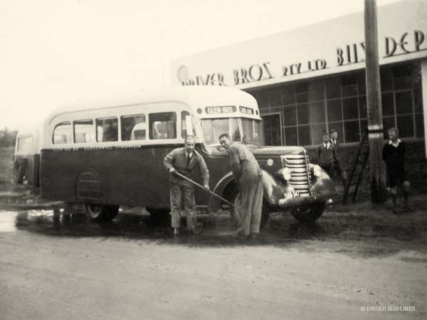 Eric and Reg Driver washing 1938 Federal Bus outside Driver Bros bus depot in glen iris (vintage photo)